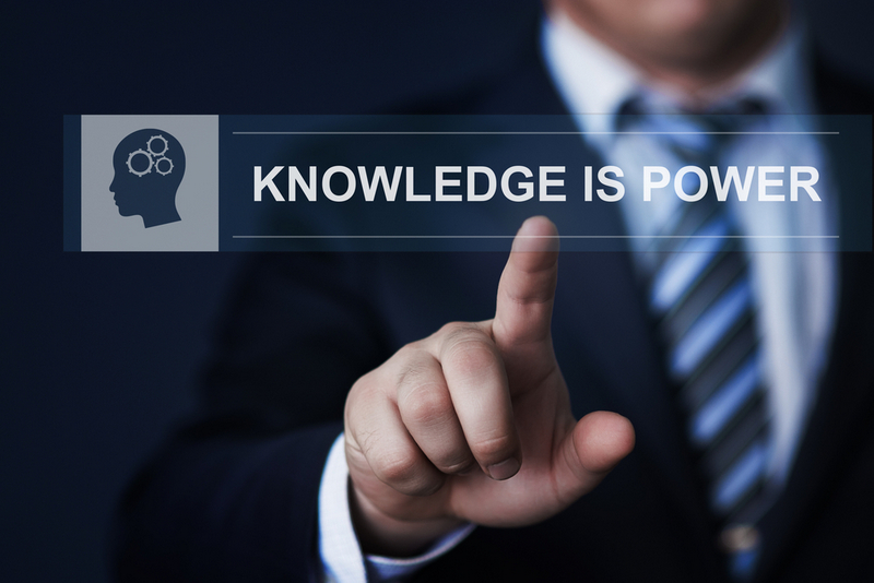 Man pressing screen saying Knowledge is Power
